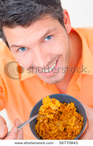 stock-photo-healthy-hungry-morning-man-eating-corn-flakes-56770843.jpg